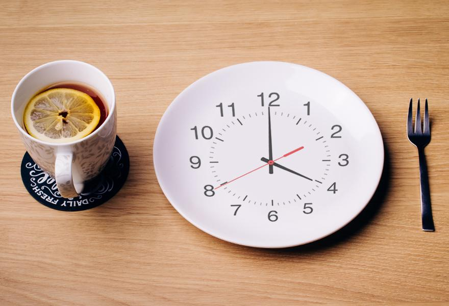 Intermittent Fasting Plate with Clock and a Cup of Tea