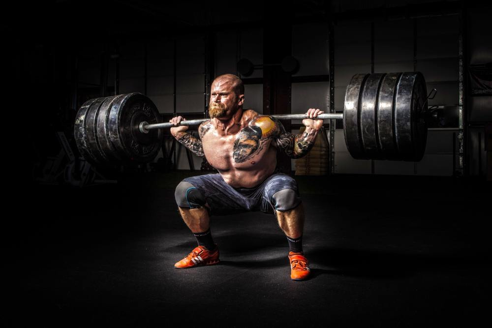 Man Weightlifting a Ton of Weight