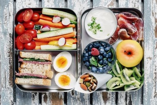 Healthy Packed Lunch with a Sandwich, Fruits, and Vegetables