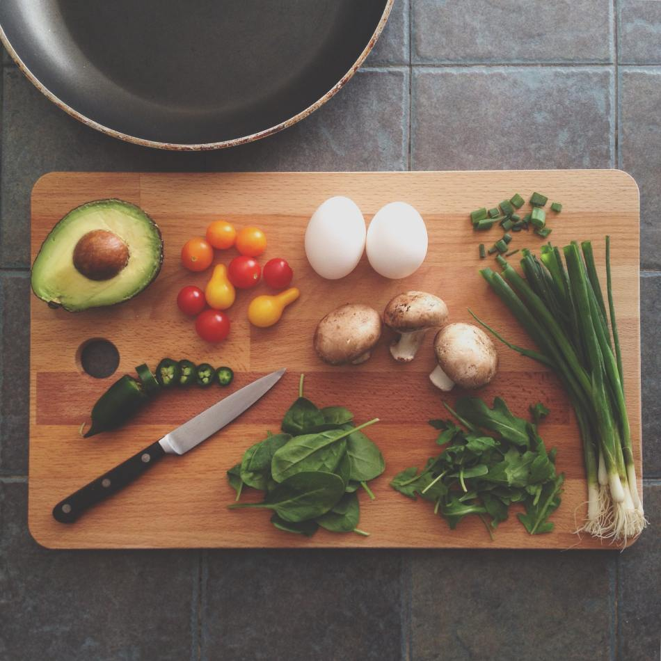 Cutting Board with Mushrooms, Spinach, Avocado, Eggs, and Green Onion