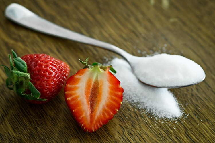 Spoon Full Of Sugar With Strawberries- How To Cut Back On Sugar