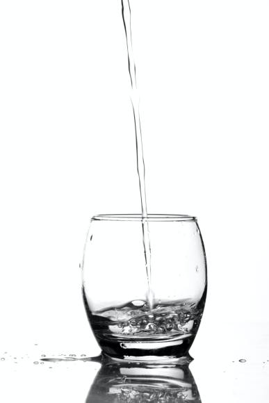 Water Being Poured in Glass - Getting Enough Water