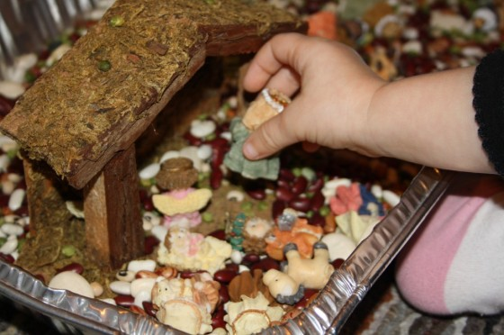 Nativity figures in a sensory bin
