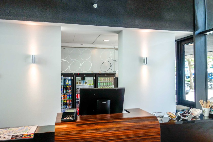 A front desk with ample cooling storage for drinks.