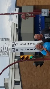 Linda & Mike at Mile '0' of the Alaska Highway