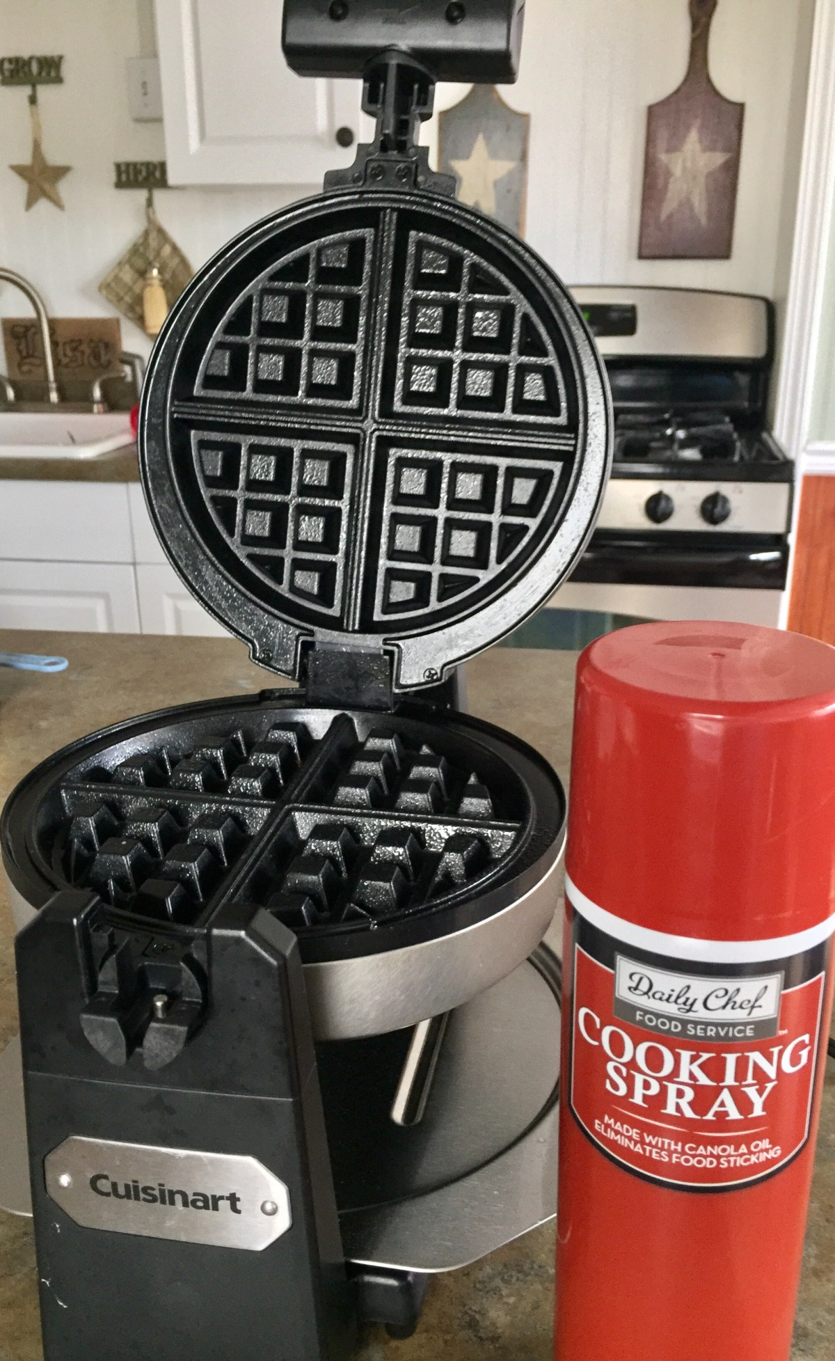 Spray waffle iron with cooking spray. Turn it on and begin to heat.