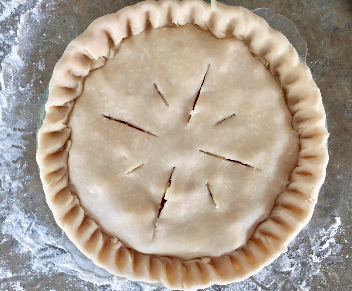 Slits are cut into the top pie crust to allow steam to escape while baking.