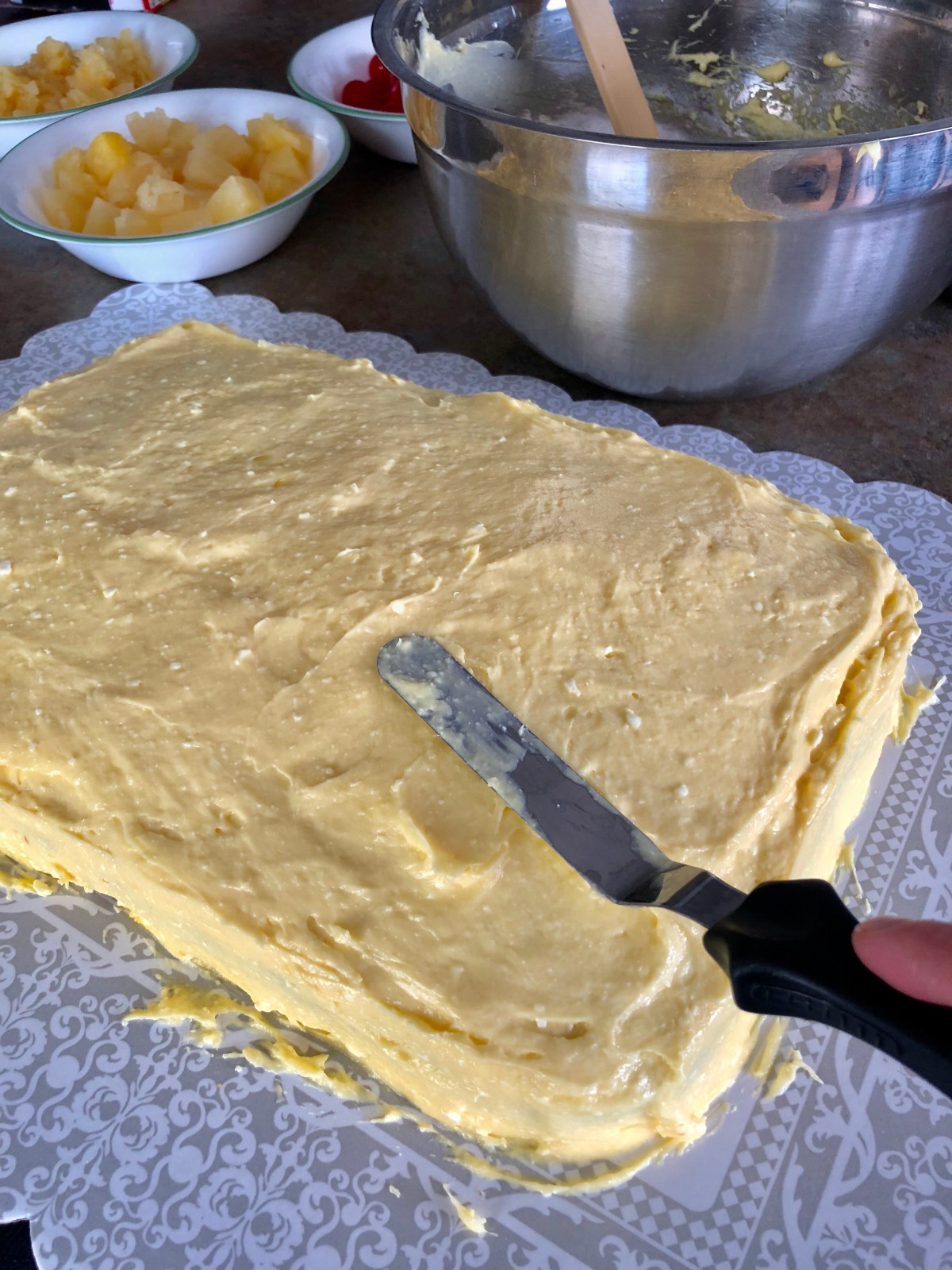 Spread the pudding mixture over top of the cake to cover.