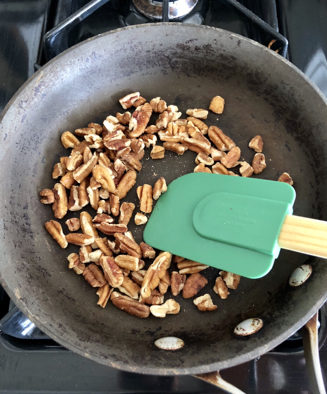 Add the pecans to a pan and cook over medium heat for 4-5 minutes.