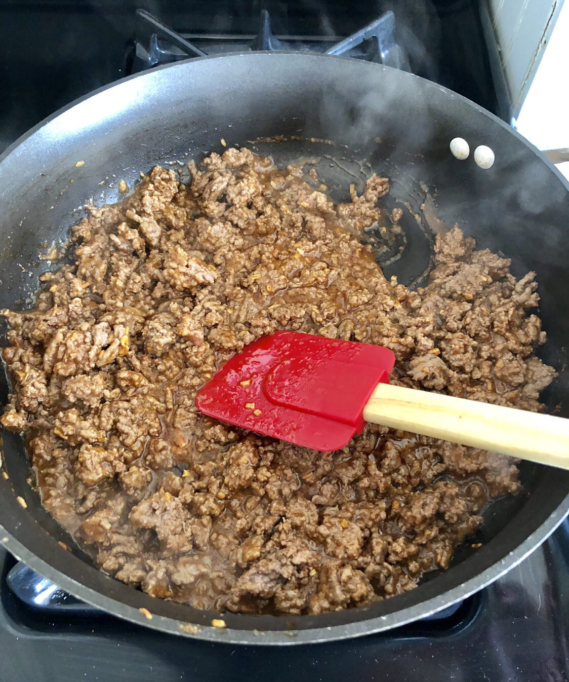 Stir in the taco seasoning and water. Bring to a boil and cook for 2 minutes. #totchos #tatertotnachos #cincodemayo #tatertotrecipes #mexicanrecipes