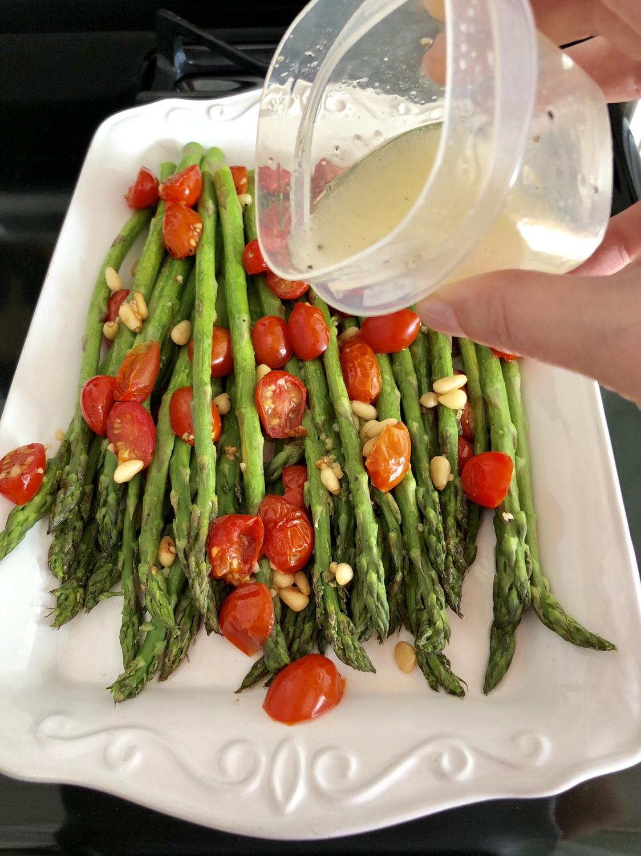 Bake in a 400 degree preheated oven for 10-15 minutes. Combine the oil and lemon juice. Drizzle over asparagus. #asparagus #roastedasparagus #sidedish #vegetablesidedish #springveggies