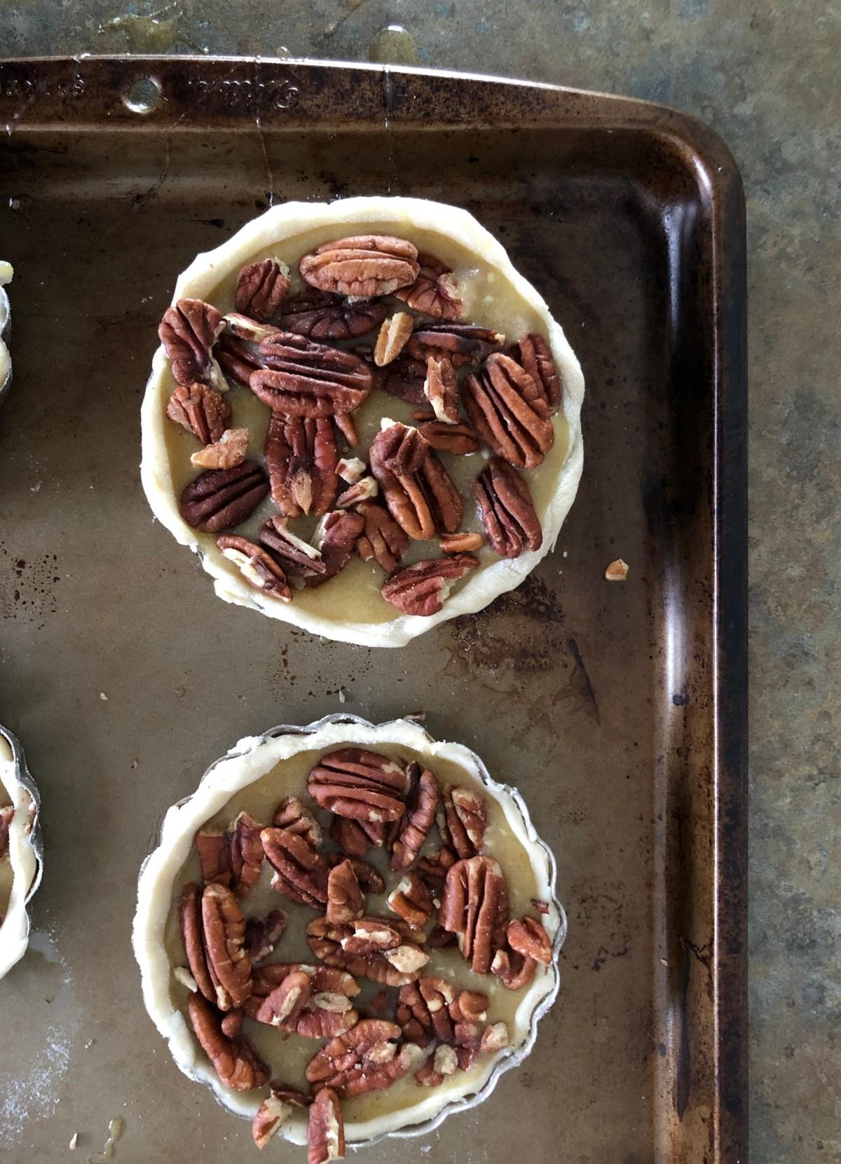 Maple Pecan Tarts by Happylifeblogspot.com #pecanpie #minitarts #pecantart #thanksgivingdessert #maplepecan #minipecantarts