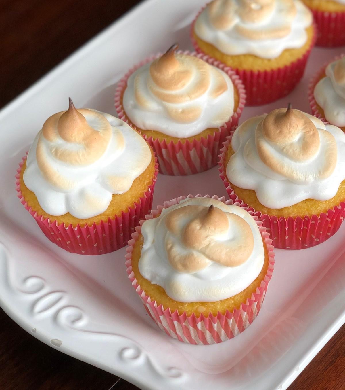 Lemon Meringue Cupcakes by Happylifeblogspot.com #lemonmeringuecupcakes #cupcakes #lemonmeringue #springdesserts #desserts #bakesalerecipes #lemoncupcakes