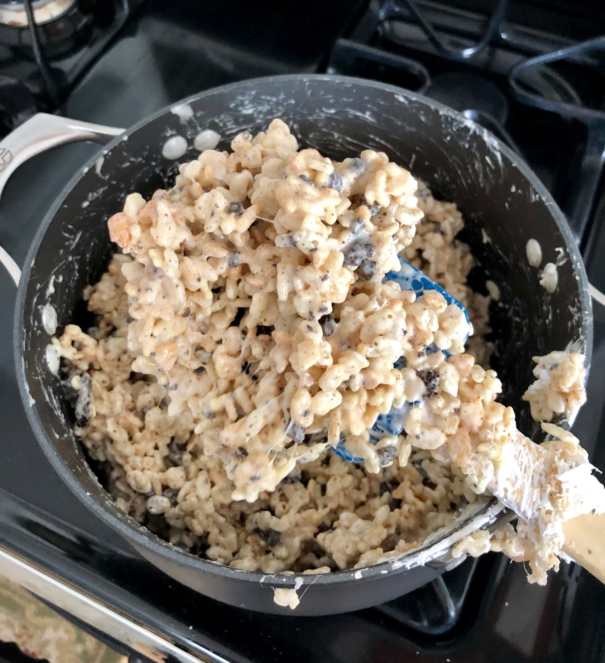 Oreo cookie chunks and Rice Krispies cereal coated in marshmallow in a Dutch oven.