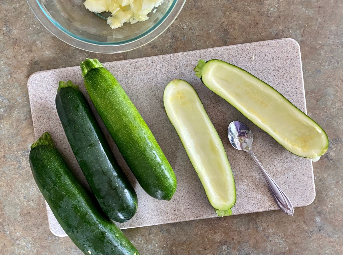 Zucchini boats cut in half lengthwise and then brushed with olive oil. #zucchini #zucchinirecipes #grilledzucchini #stuffedzucchini #lowcarbdinner #healthydinnerrecipes