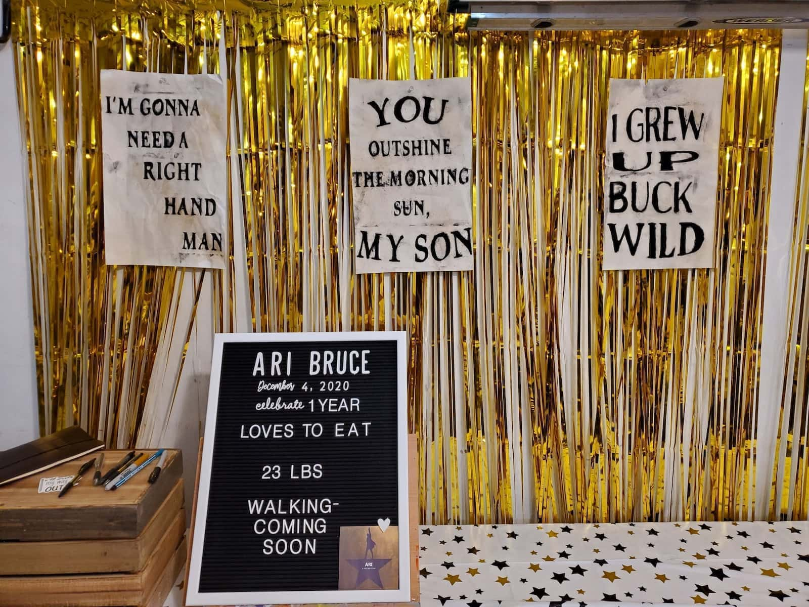 Gold streamers with signs: I'M GONNA NEED A RIGHT HAND MAN, YOU OUTSHINE THE MORNING SUN, MY SON, I GREW UP BUCK WILD