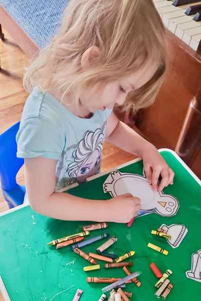 Photo of girl drawing a penguin