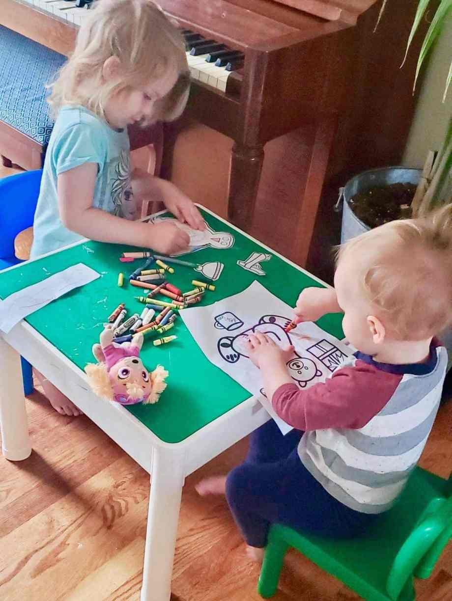 Photo of boy and girl coloring