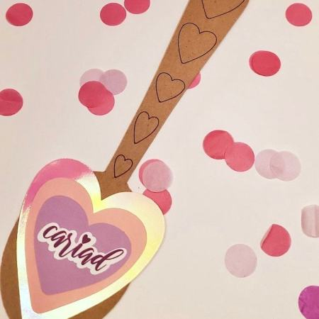 Photo of brown spoon with pink hearts
