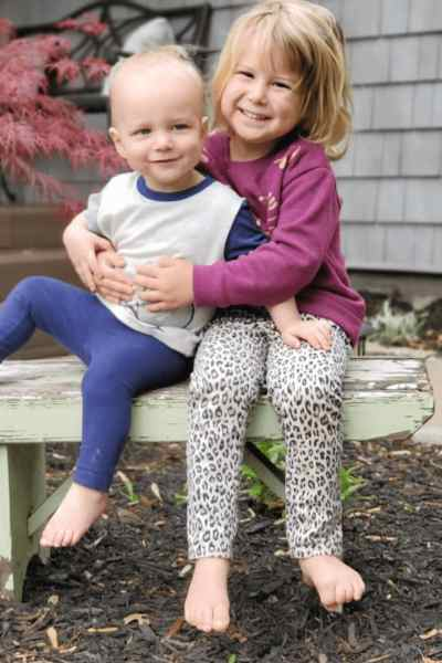 Picture of a little girl hugging her little brother
