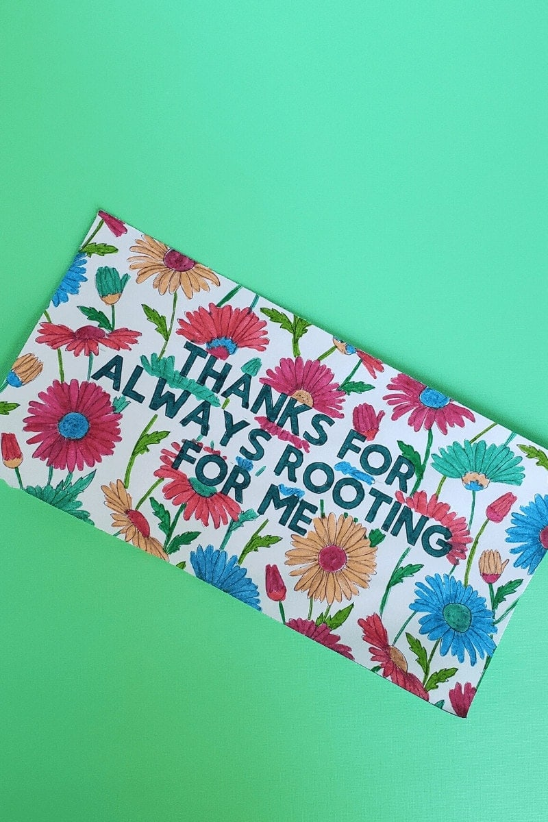 Picture of a card with flowers: THANKS FOR ALWAYS ROOTING FOR ME