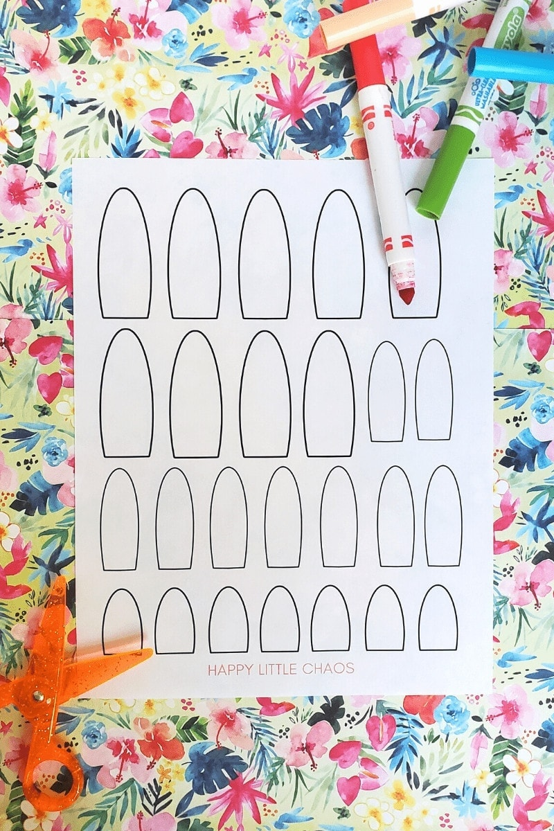 picture of a piece of paper with arches on it, markers, and scissors