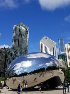 8 Awesome Things to Do with Kids in Chicago's Millennium Park. Visit the Lurie Gardens and the Cloud Gate or the Bean as locals call it. Let the kids splash in the Crown Fountain and in the winter go ice skating at the park. Plan your trip to this Illinois park with this helpful guide. Learn where to park and eat too! #millenniumpark, #chicagoattractions, #traveltips, #familyvacation