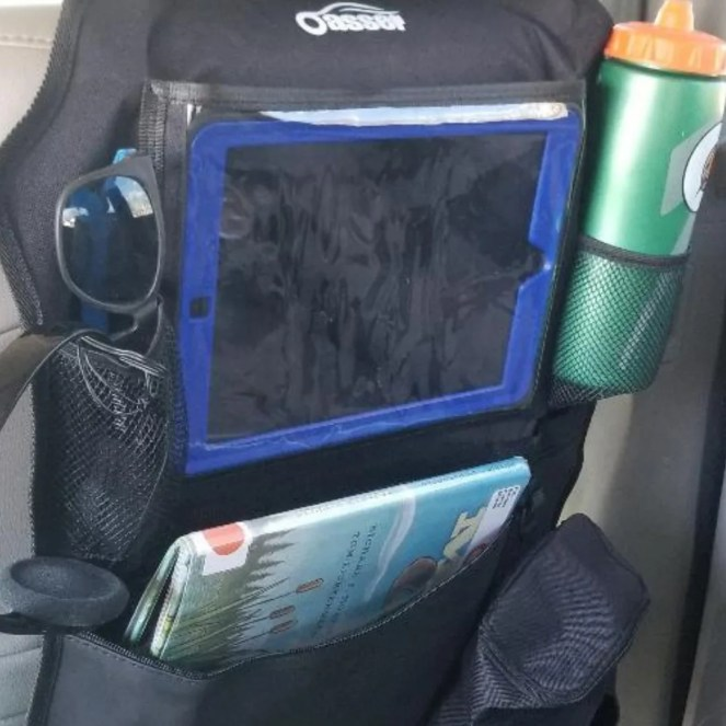 #Affiliate - The best Car Kick mat for family vacation. Holds kids eye pads, drinks and huge pocket for books and activities. Love that sides on iPad holder open to plug in earphones or charger. Great for road trips.