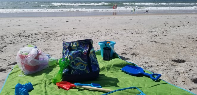 How to make a fun beach day by setting up your spot with all your cool beach hacks.
