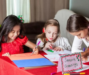 Kids Making Christmas Cards as gifts for family and friends.