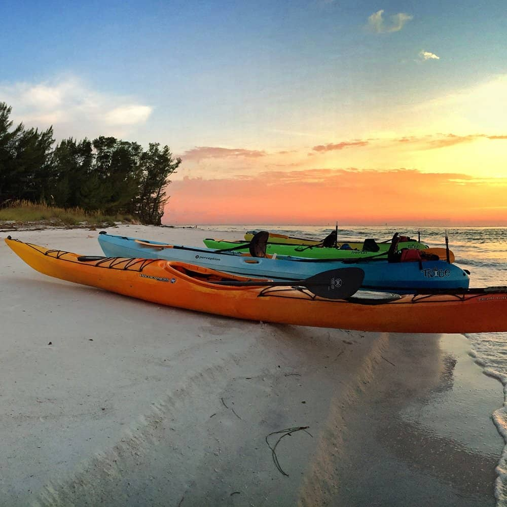 Sunset tour on Beer Can Island at Longboat Pass with kayaks on beach