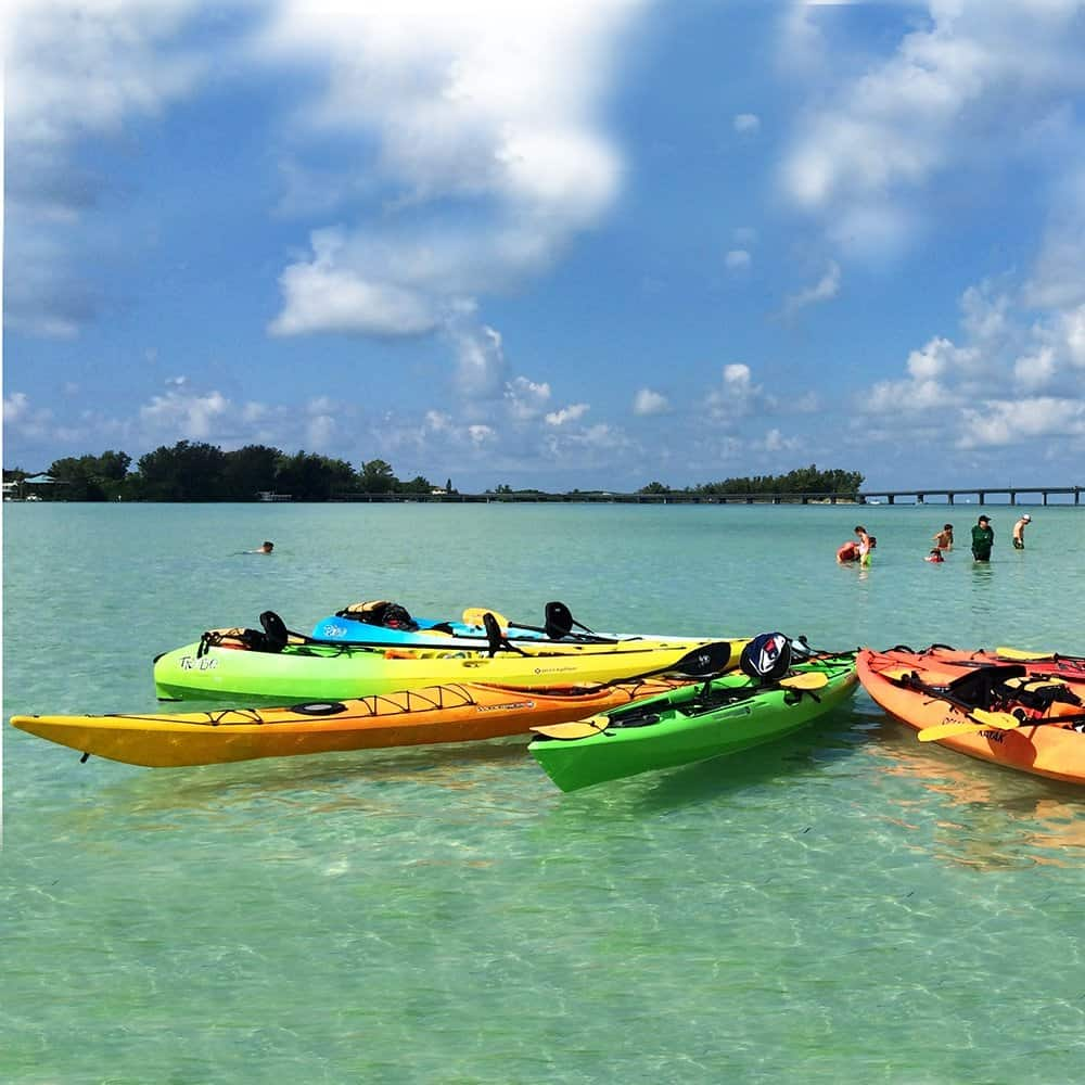 Kayak tour group on the Coastal Island Tour in the crystal clear waters of Longboat Pass