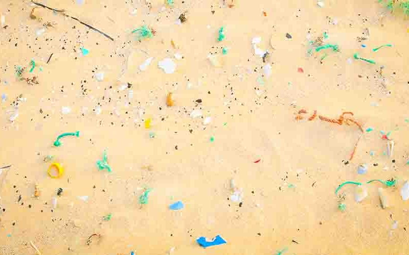 Microplastics on sandy beach