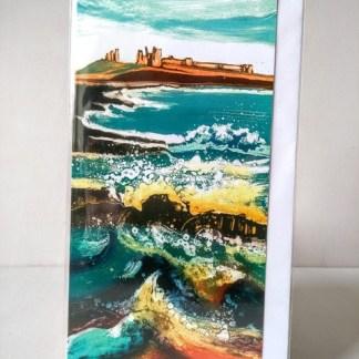 crashing waves dunstanburgh