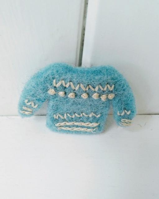 blue jumper brooch