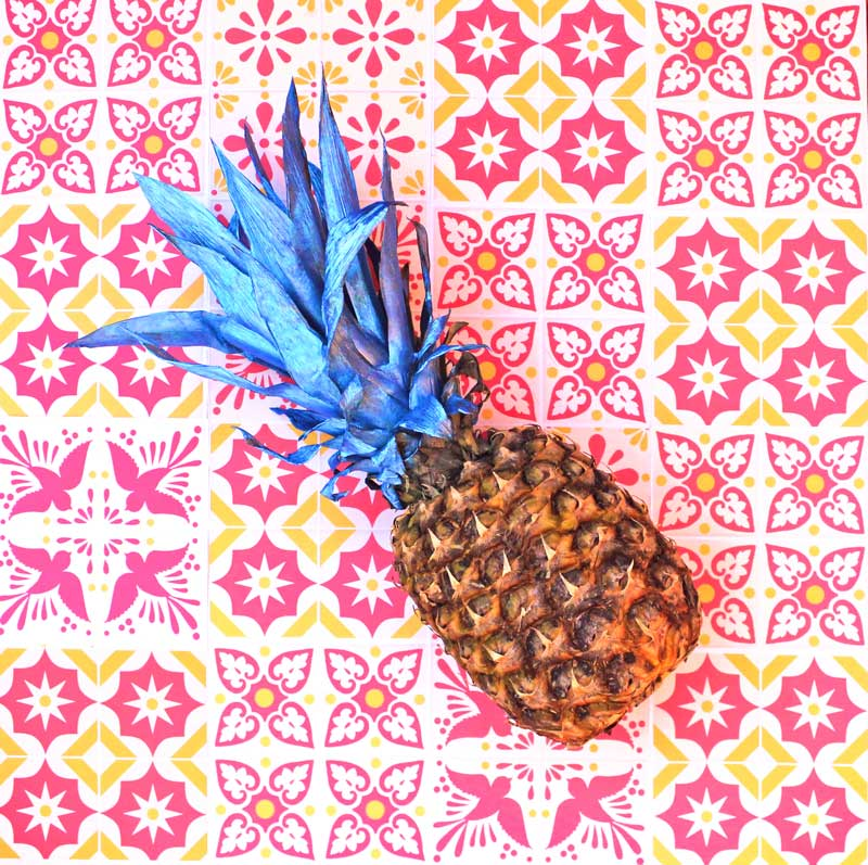 Blue pineapple in front of printable DIY talavera tiles