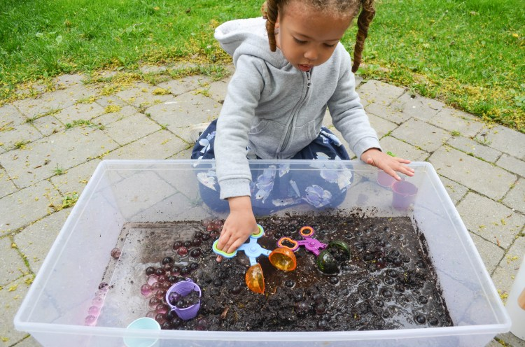 Water beads in mud sensory bin for toddlers and preschoolers