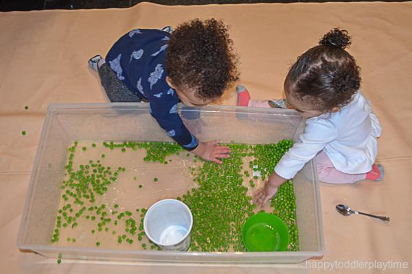 green pea sensory bin for toddlers and preschoolers