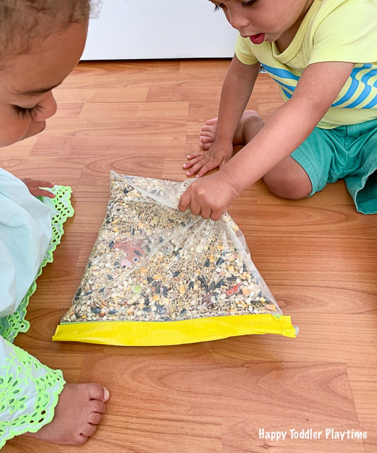 Toddlers playing with a farm sensory and discovery bag