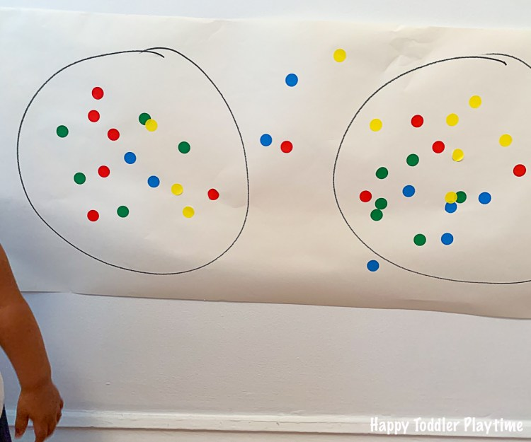 Fine motor game using dot stickers for toddlers
