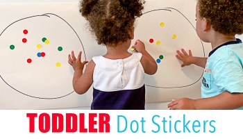 toddlers playing with dot stickers for a fine motor activity