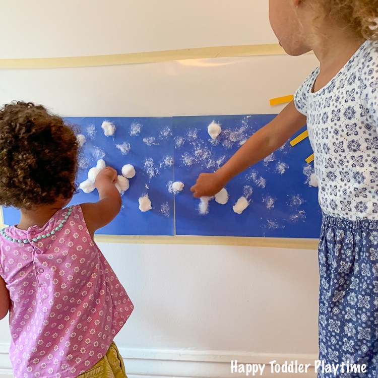 cloudy day sticky wall activity for toddlers using contact paper
