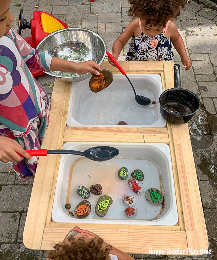 A toddler activity using DIY leaf rocks in water