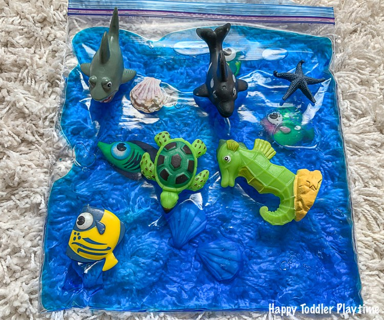 Ocean animals and sea shells in a ocean sensory play bag for toddlers