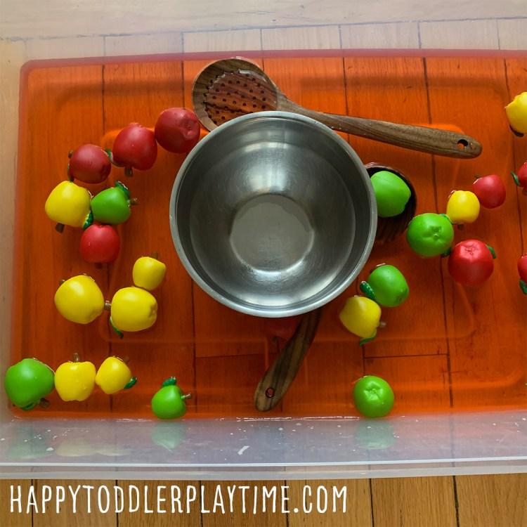 apple soup sensory bin