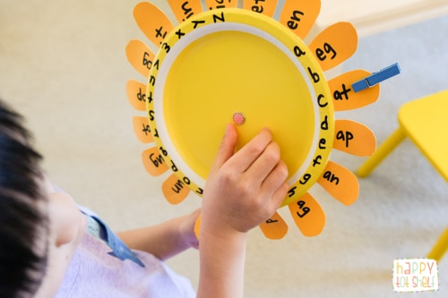 My son practicing his word families with the sunflower.