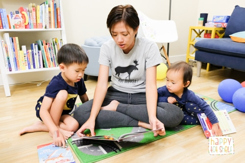 Mom reading to kids