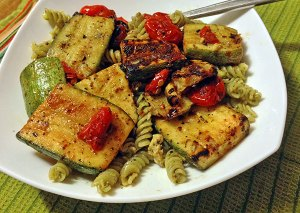 vegan pesto pasta with grilled calabacita and tomatoes.