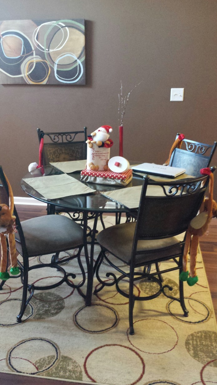 """Santa and his reindeer are """"hanging"""" out on the chairs. I made the centerpiece! (so proud)"""