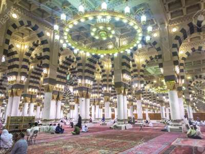 AL MADINAH, KINGDOM OF SAUDI ARABIA - MAR 07: Muslim pray and read Quran inside Masjid (mosque) Nabawi on March 07, 2015 in Al Madinah, S. Arabia. Nabawi mosque is the 2nd holiest mosque in Islam.